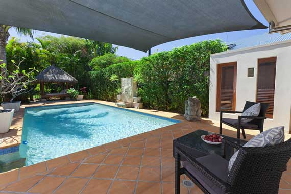 Relax in the shade and leave the pool cleaning to Tropical Scapes.