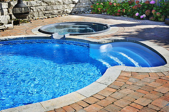Cleaned swimming pool by Tropical Scapes.